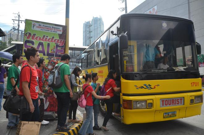 Pinoy Archies lined up as they enter the bus.